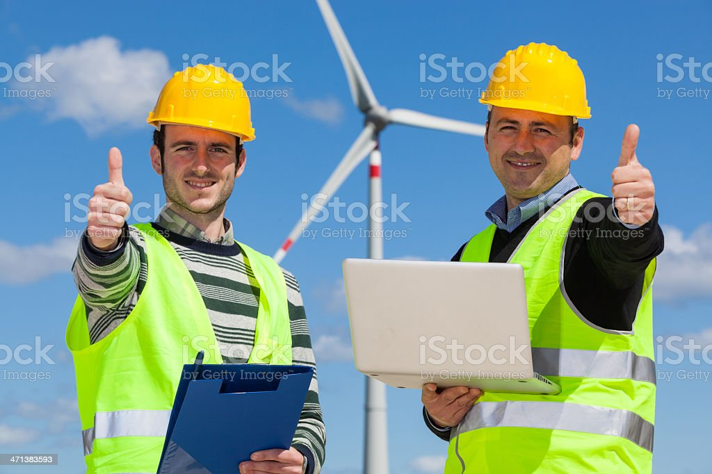 Engineers at Work in Wind Turbine Power Station royalty-free stock photo