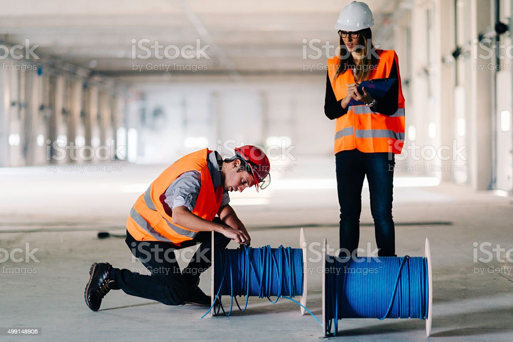 Engineers checking electrical cables stock photo