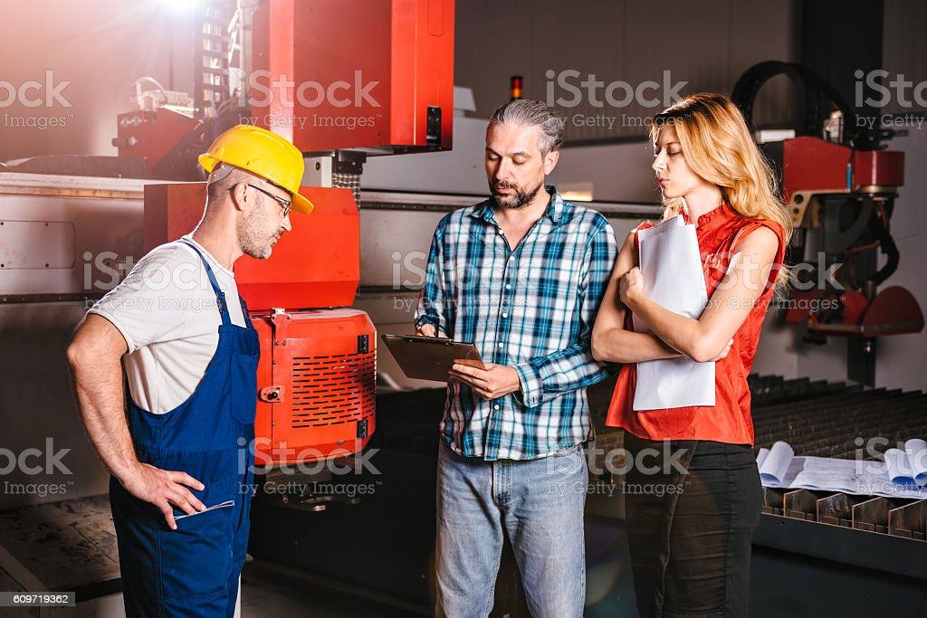 Engineers checking installation of new CNC plasmas machine stock photo
