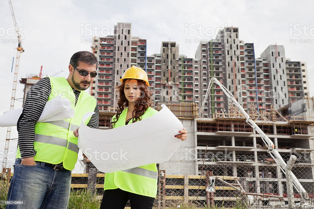 Engineers checking plan at construction area royalty-free stock photo