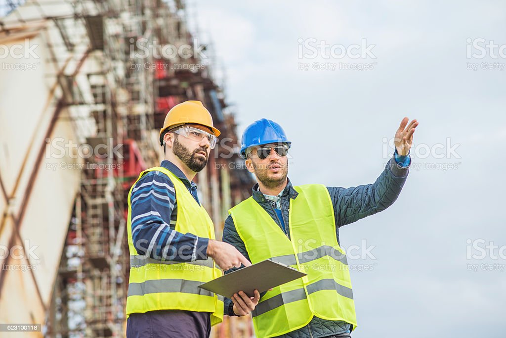 Engineers discussing successful project accomplishment stock photo