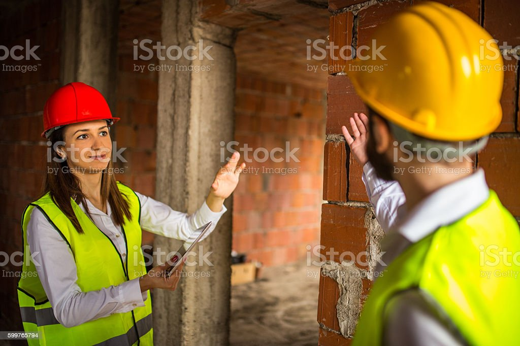 Engineers doing their job stock photo