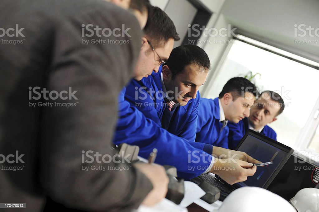 Engineers drawing new vehicle part royalty-free stock photo