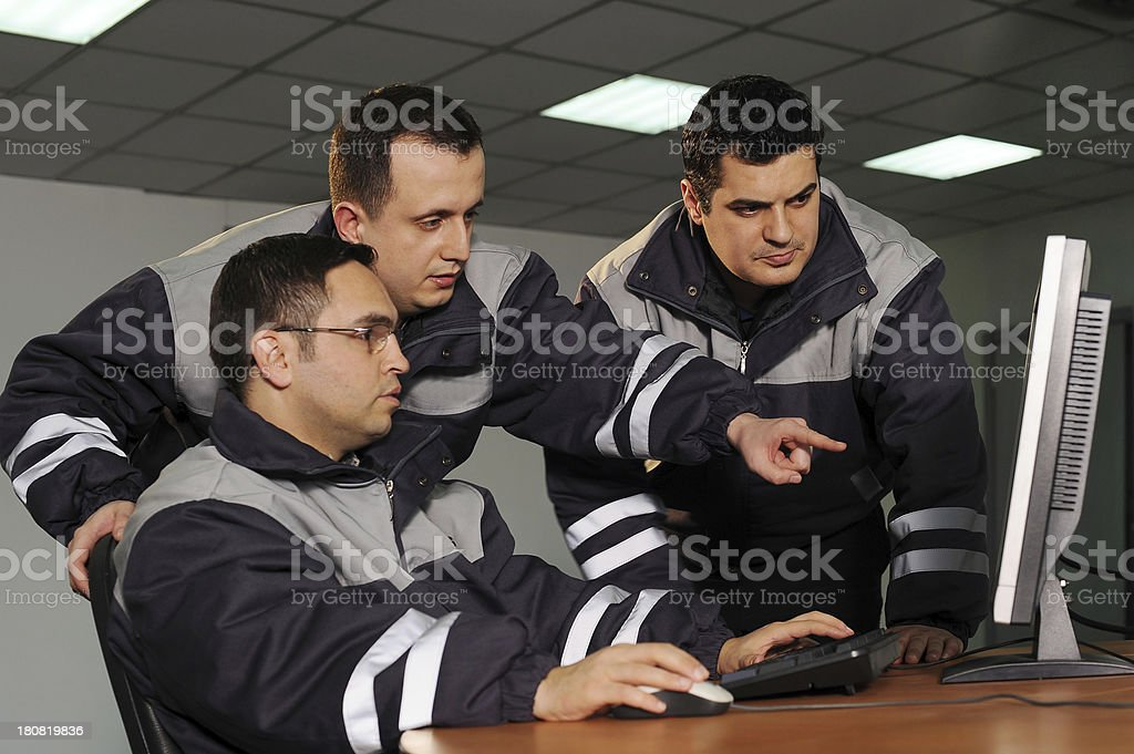 Engineers helping colleague royalty-free stock photo
