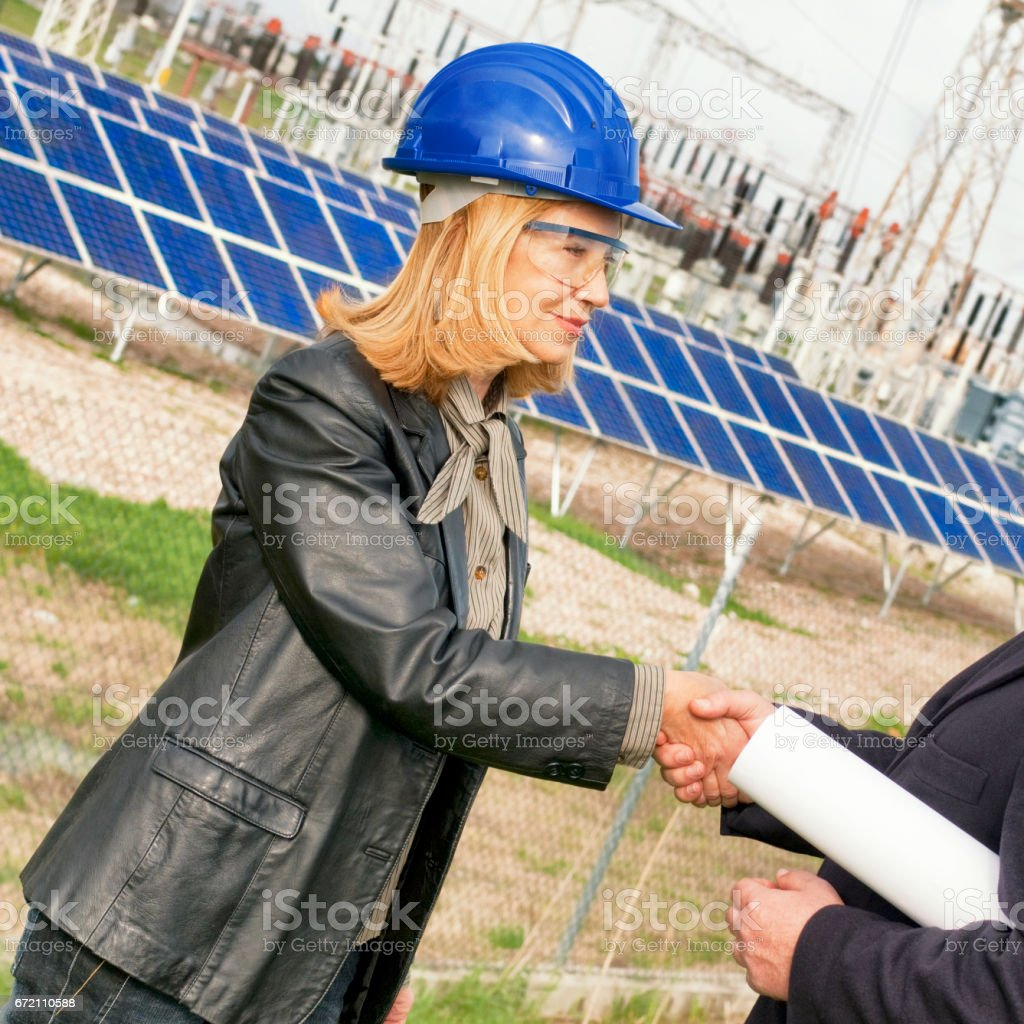 Engineers in a solar panel site stock photo