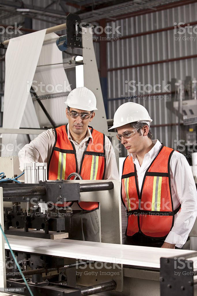 Engineers in Outsourcing Printing Industry royalty-free stock photo