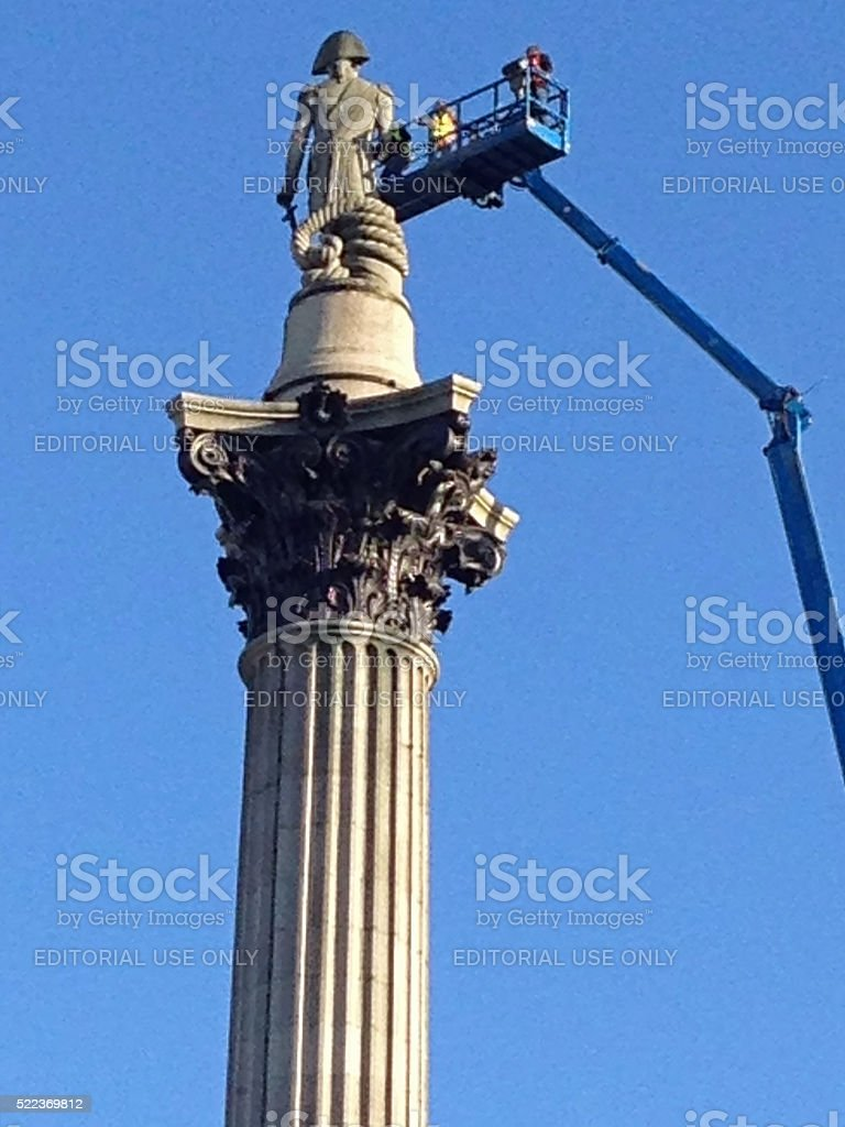 Engineers inspecting Nelson's Column, London stock photo