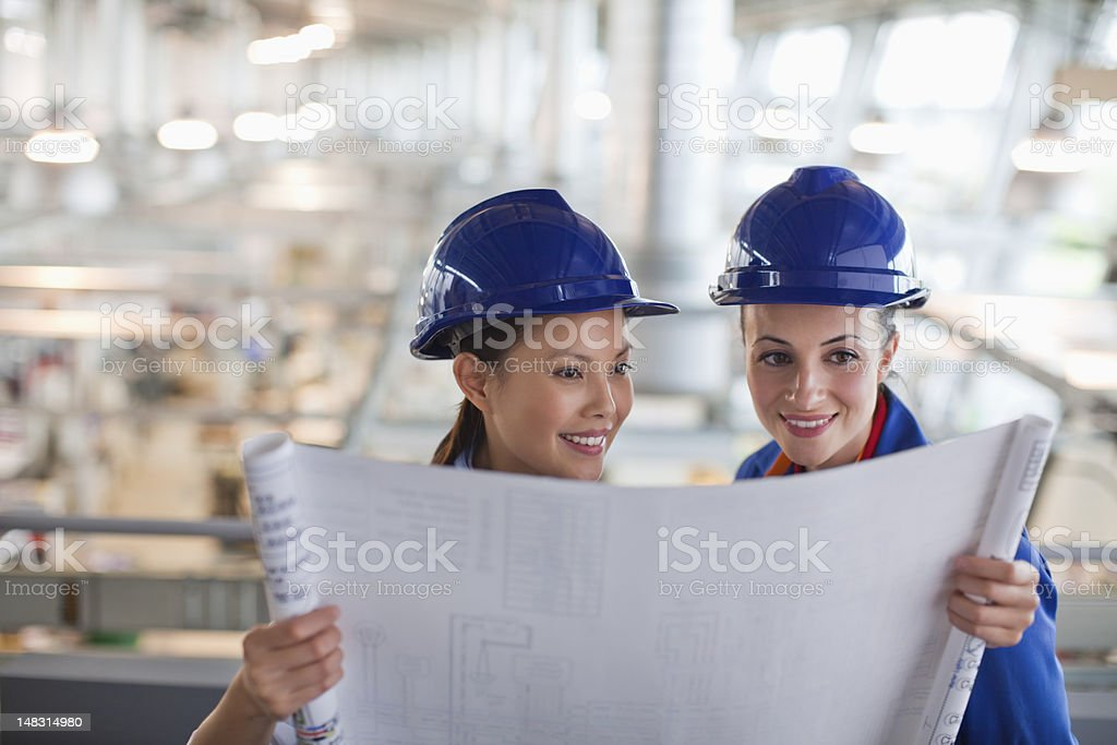 Engineers looking at blueprint royalty-free stock photo