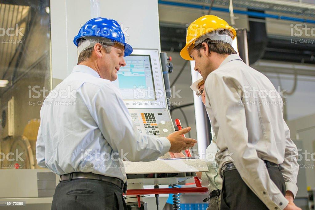 Engineers Programming A CNC Machine stock photo