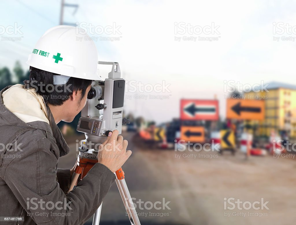Engineers use tacheometer or theodolite with construction road w stock photo