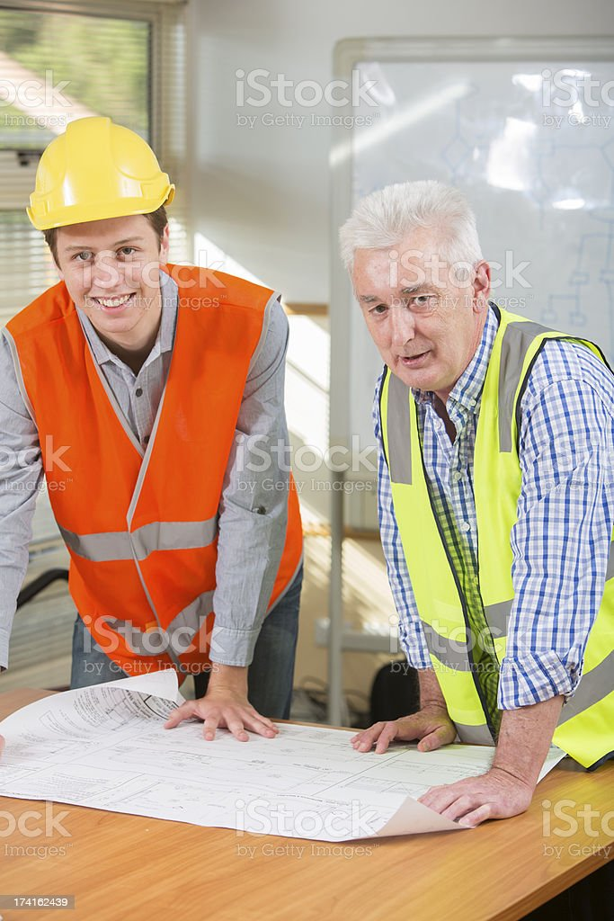 Engineers WIth Plans royalty-free stock photo