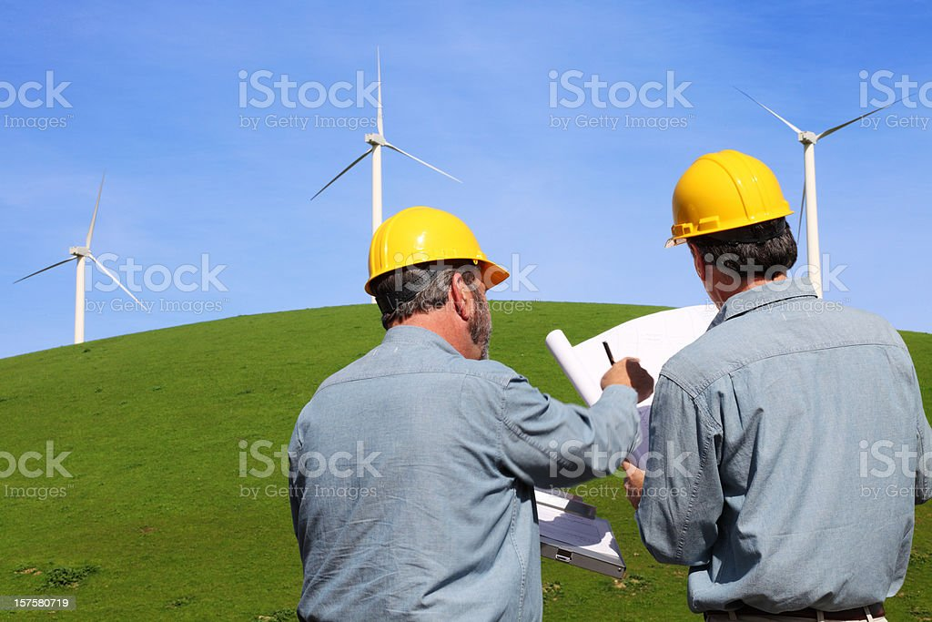 Engineers Working On Windmills royalty-free stock photo