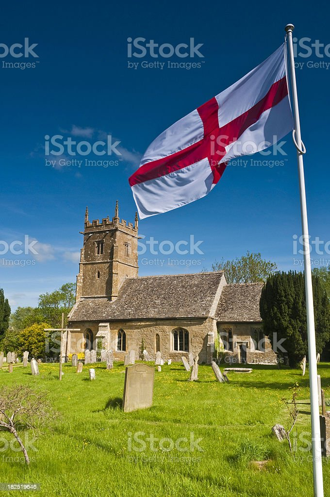 England Cross of St George patriotic flag country village church stock photo