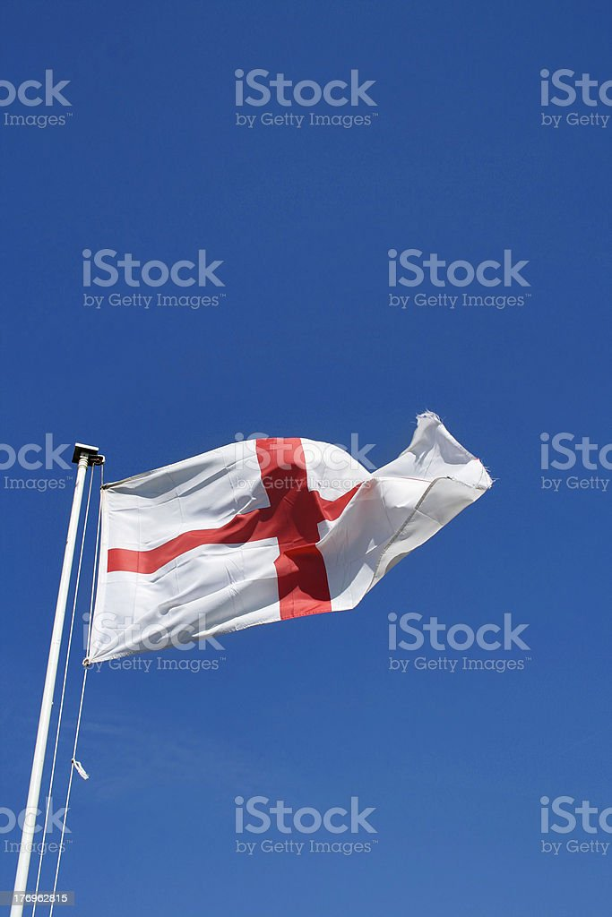 England flag blowing in wind stock photo