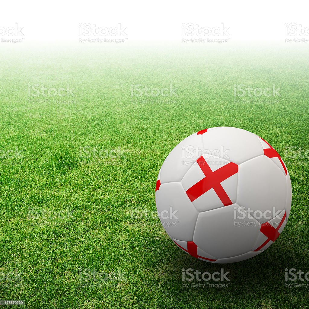 England flag on 3d football in grass royalty-free stock photo