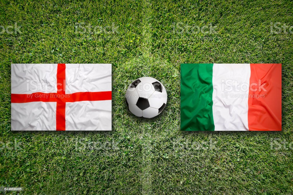 England vs. Italy flags on soccer field stock photo