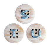 English alphabet of embroidery on wooden botton