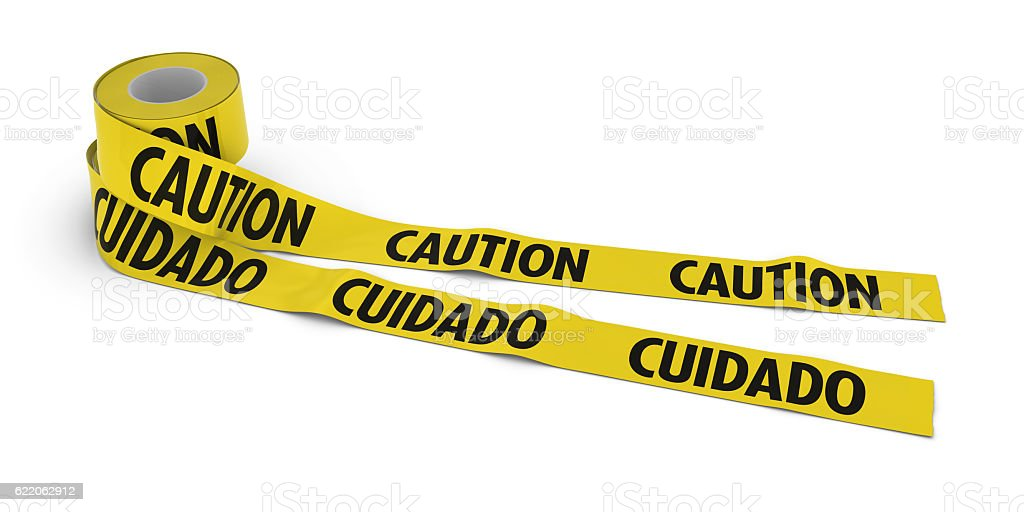 English and Spanish CAUTION and CUIDADO Tape Rolls unrolled stock photo