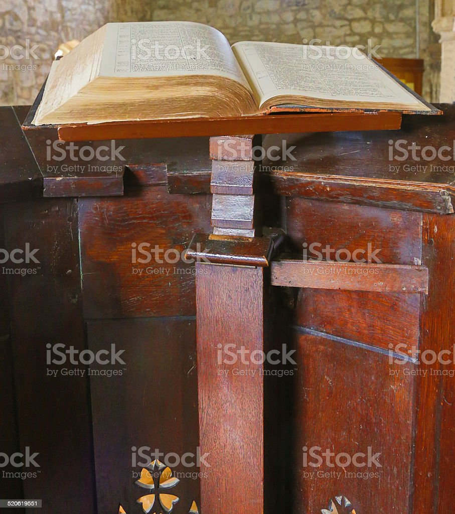 English Anglican Church pulpit with old fashioned bible open stock photo