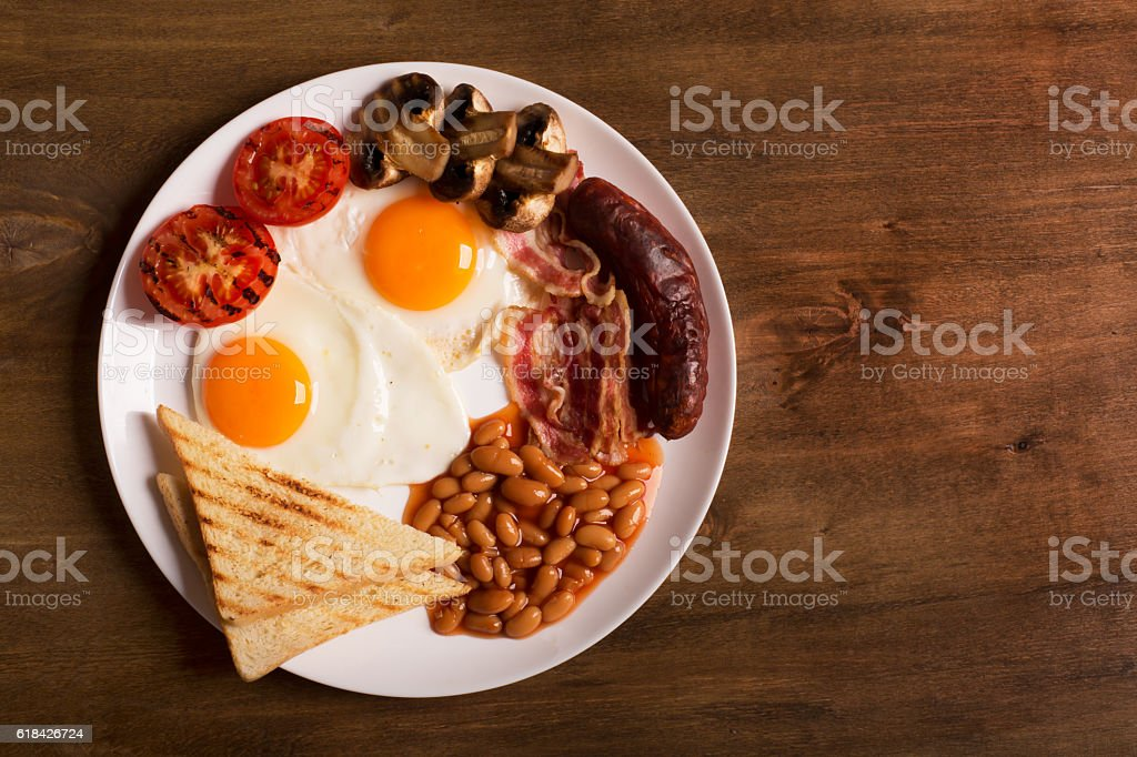 English breakfast on a white wooden table stock photo