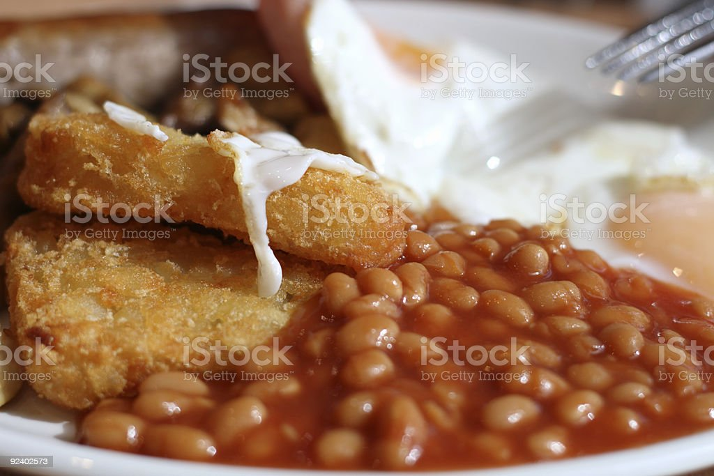 English breakfast  tomato baked beens hash browns and eggs close-up royalty-free stock photo