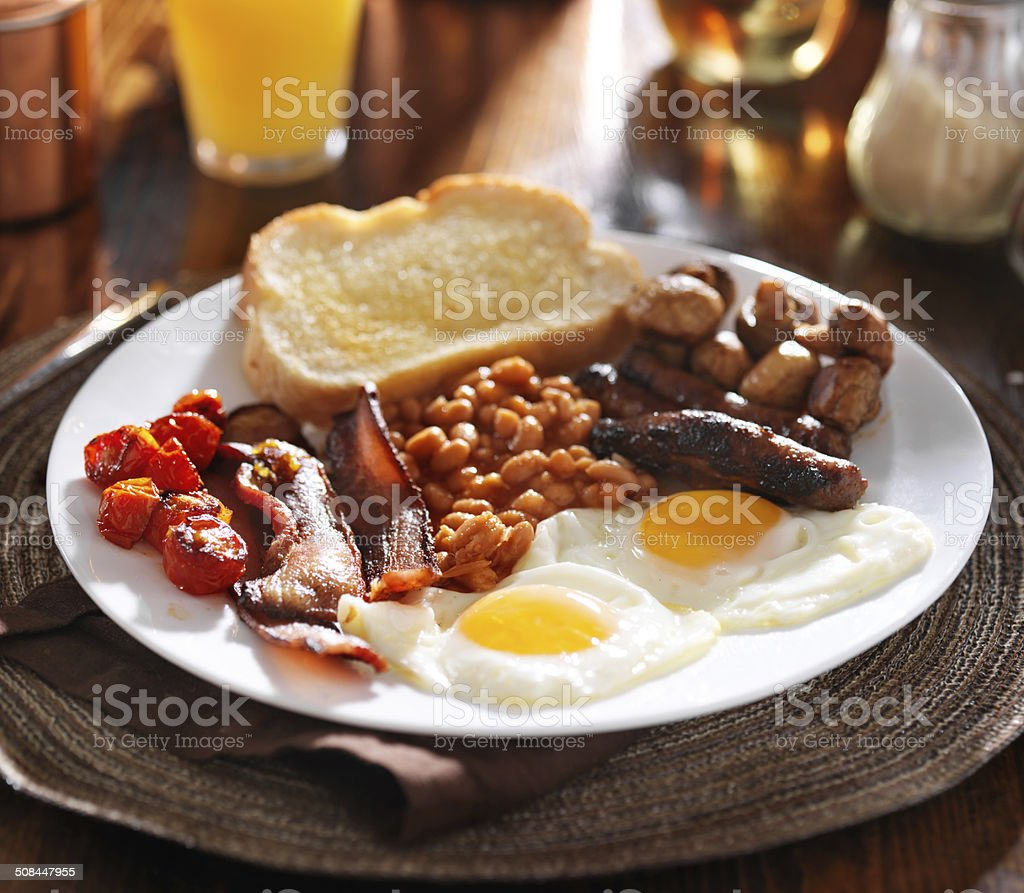 english breakfast with eggs, tomatoes, mushrooms, bacon, beans, stock photo