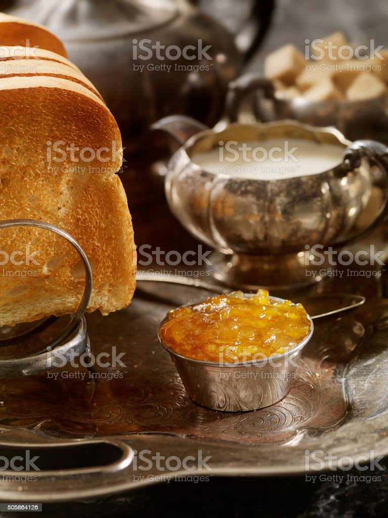 English Breakfast with Toast, Orange Marmalade and Tea stock photo