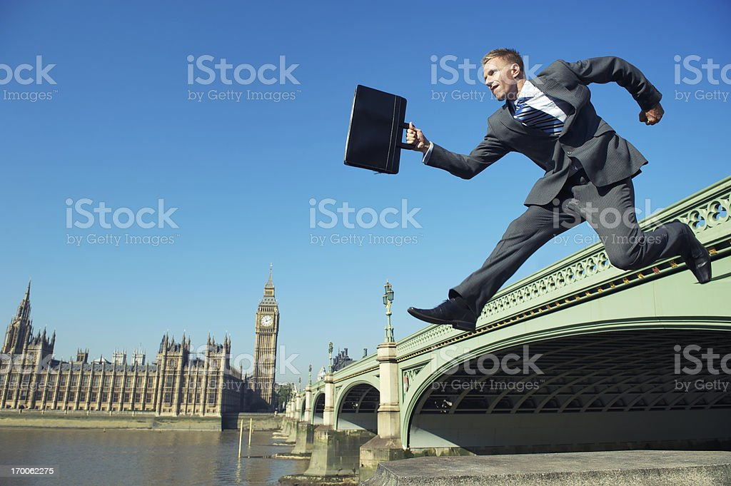 English Businessman MP Jumping at Westminster Bridge London royalty-free stock photo