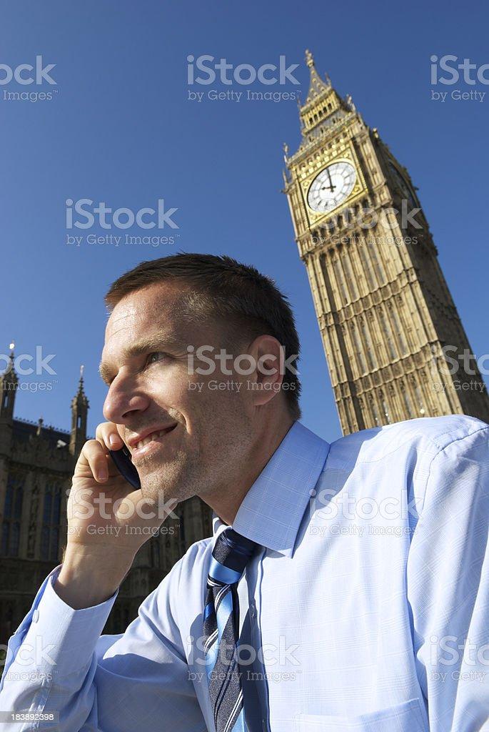 English Businessman Talking on Mobile Phone at Big Ben London royalty-free stock photo