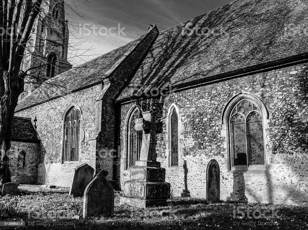 English chapel with gravestones to the front stock photo