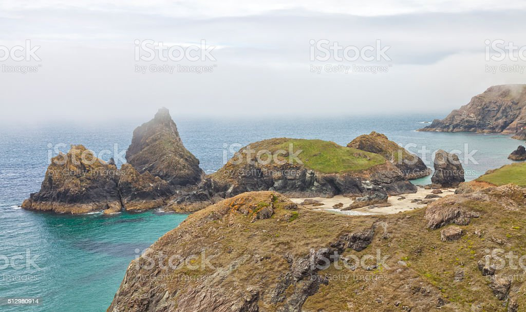 English coast landscape with sandy beach, rocks on foggy day stock photo