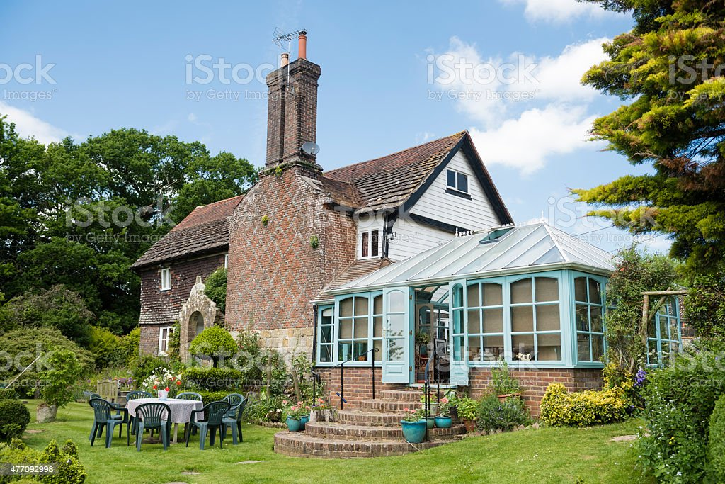 English country cottage in summer stock photo