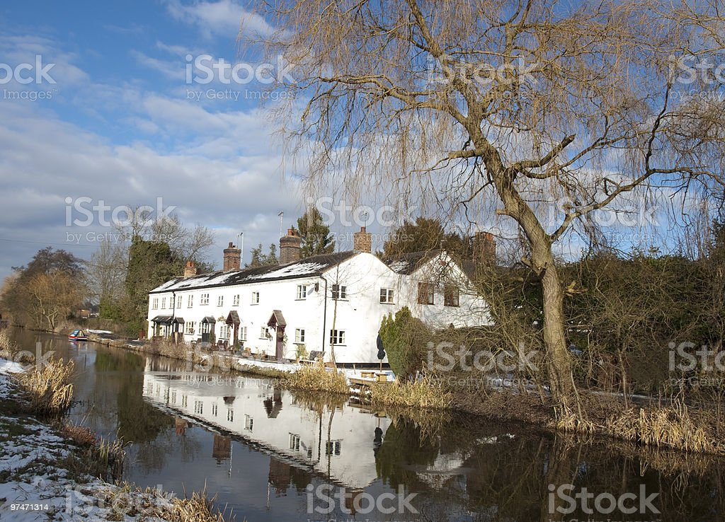 english countryside in staffordshire canal house reflection walk stock photo