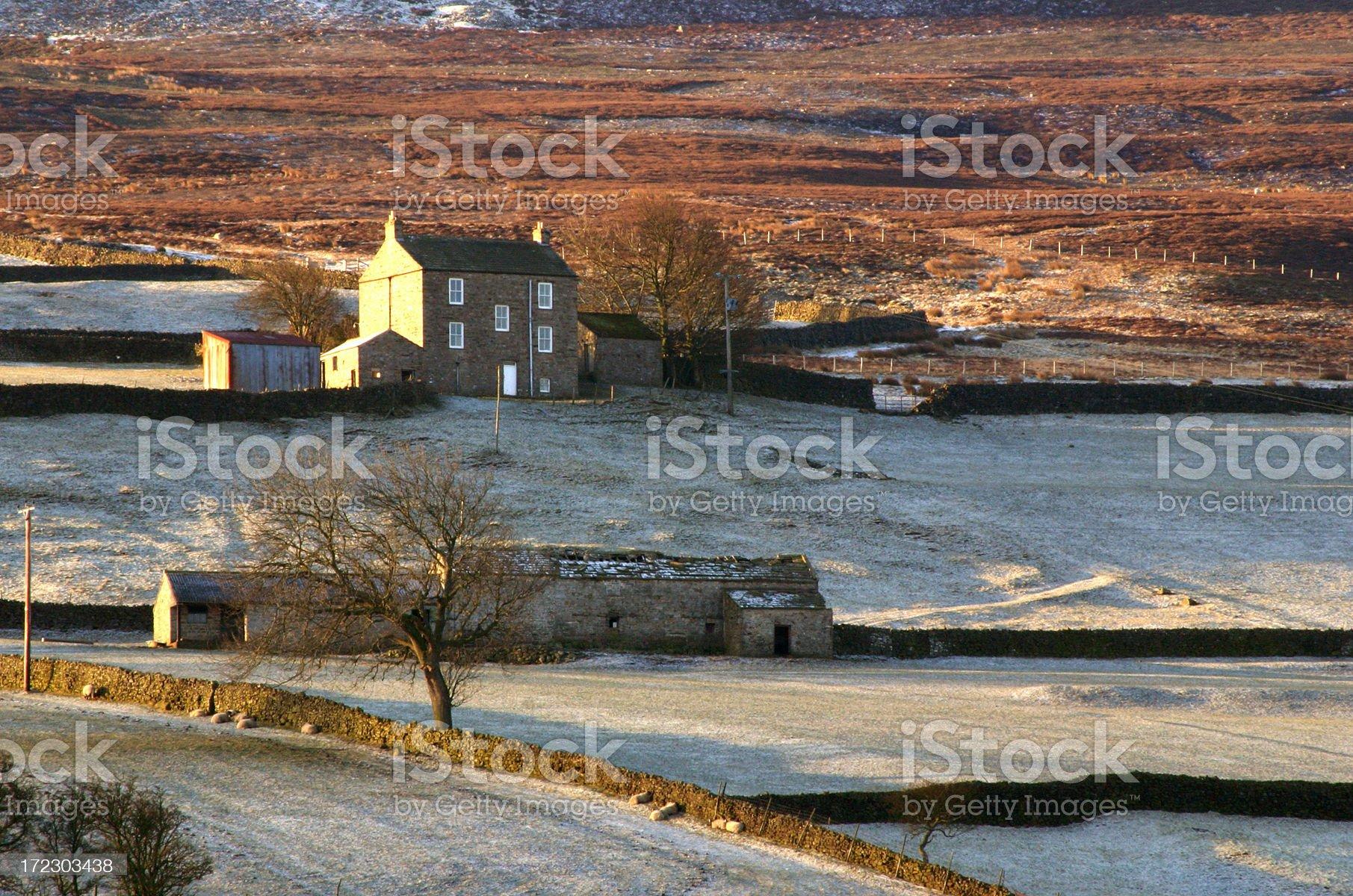 English farmhouse in winter sunshine royalty-free stock photo