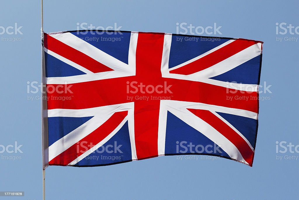 English flag in wind against a sky royalty-free stock photo
