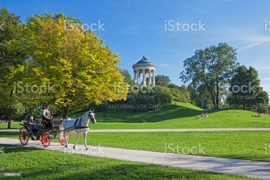 English Garden with Monopteros and Horsedrawn Carriage stock photo