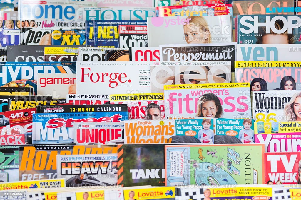 English language magazine stack stock photo