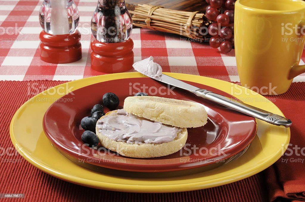 English muffin with blueberry cream cheese stock photo