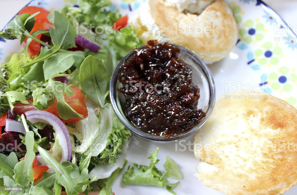 English muffins with grilled goat's cheese, salad, onion marmalade relish royalty-free stock photo
