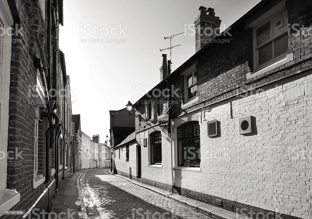 English paved side street stock photo