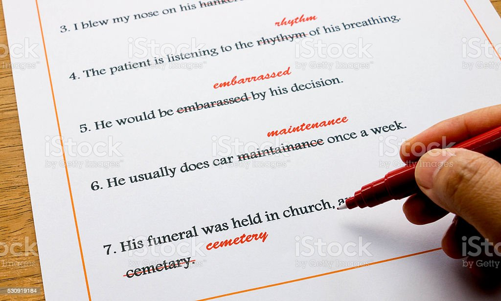 english spelling correction sheet on table stock photo