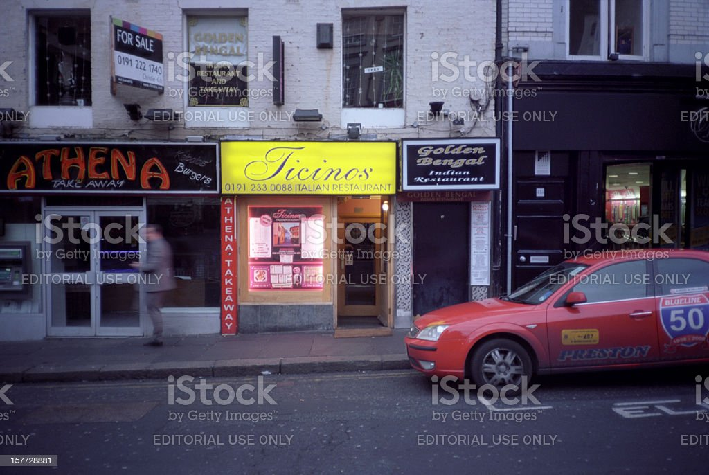 English street at the evening, with shops stock photo