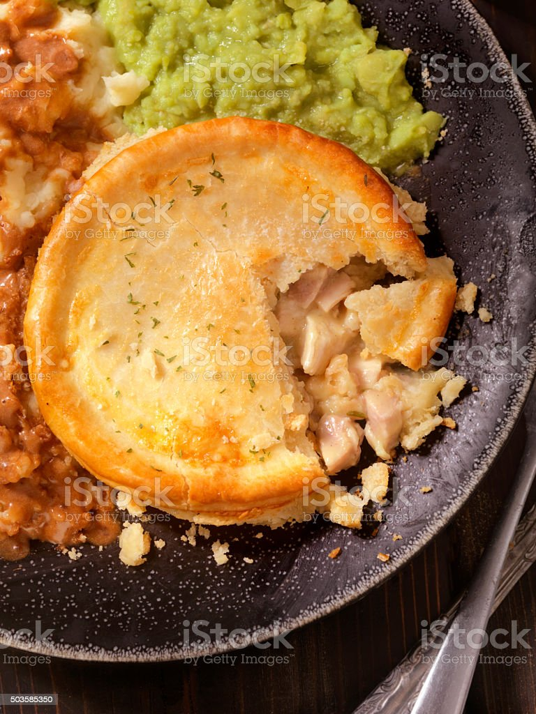 English Style Meat Pie with Mushy Peas and a Beer stock photo