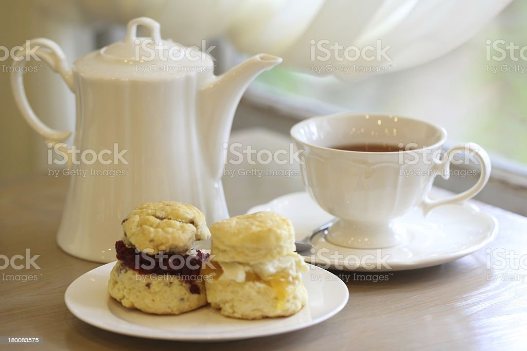 English teatime with tea and pastry with jam stock photo