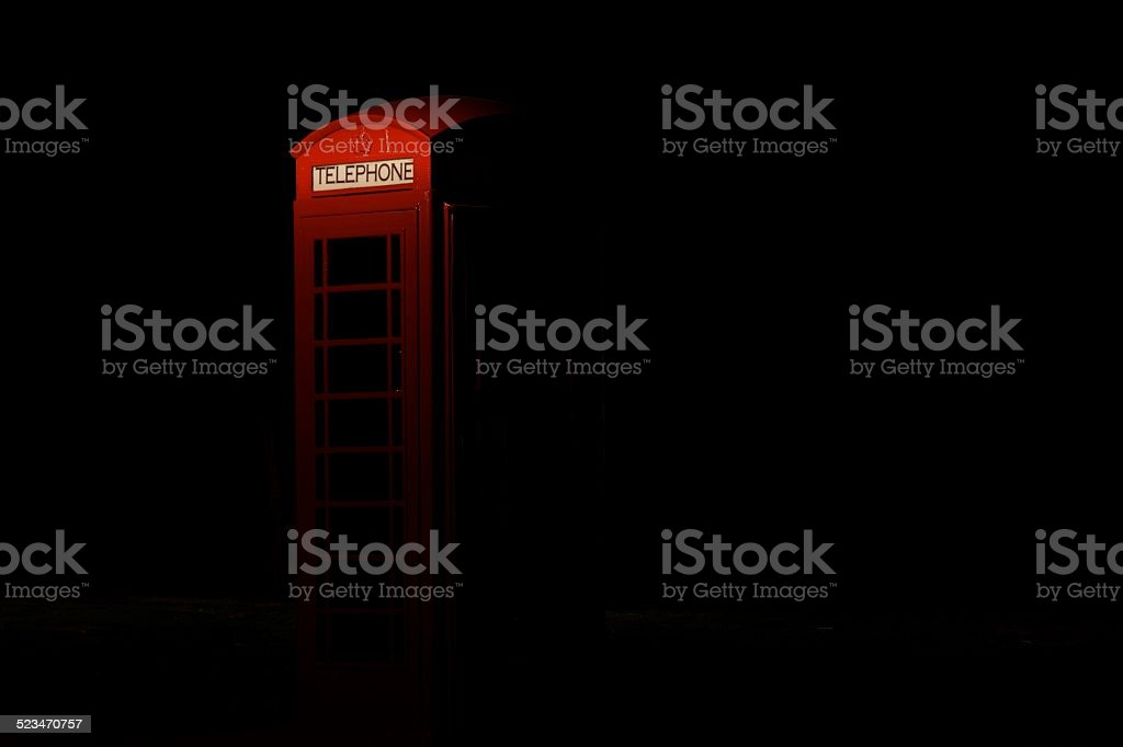 English telephone booth at night stock photo