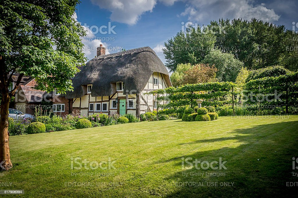 English Thatched Cottage and garden stock photo