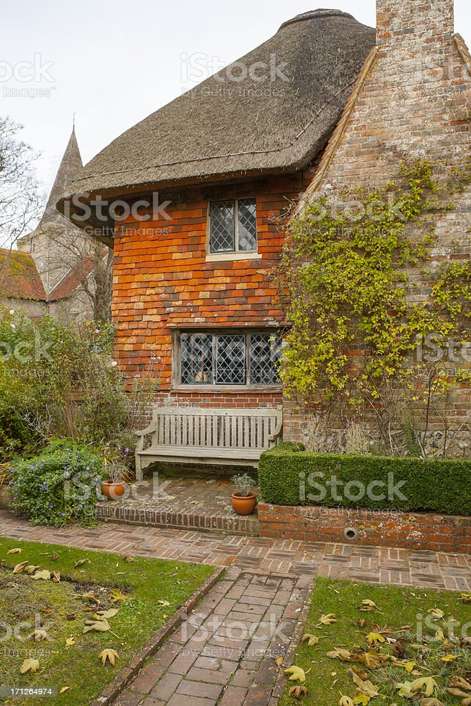 English Thatched Cottage with Leaded Windows stock photo