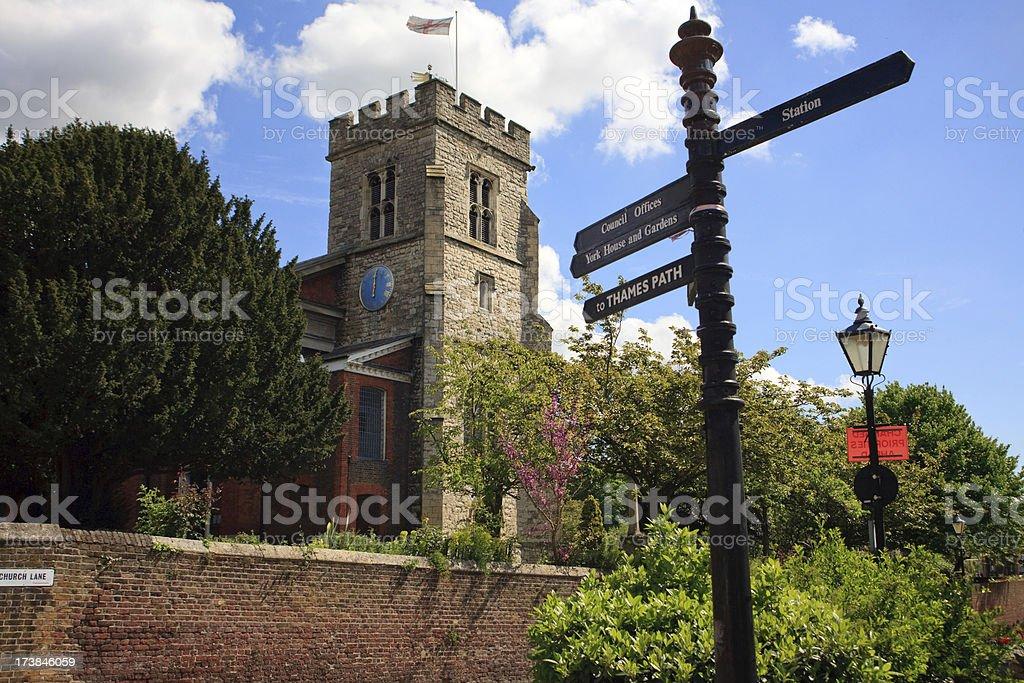 English village church and signpost stock photo