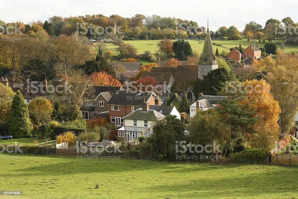 English Village with church in Autumn stock photo