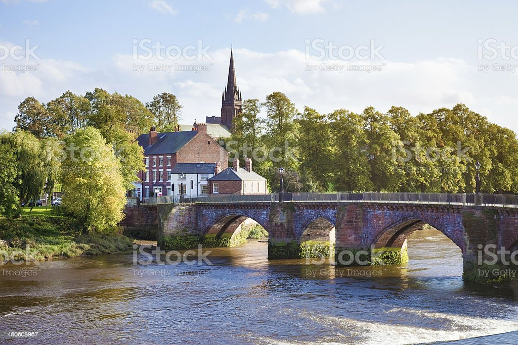 English village with stone bridge stock photo